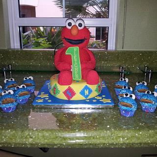 elmo cake with cookie monster cupcakes