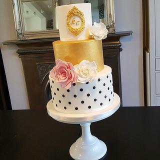 Polka dots and roses wedding cake