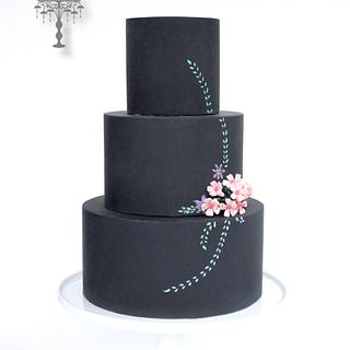 Chalk board cake with hand painted flowers, leaves with sugar flower