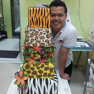 wedding cake Safary themed with sugar gumpaste flowers
