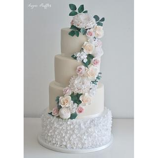 Cascading sugar flowers and petal ruffles