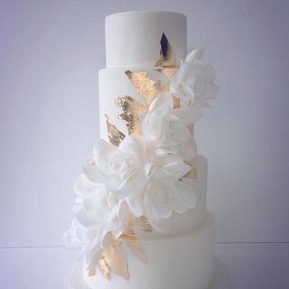 Cascading wafer paper roses and gold leaf wedding cake