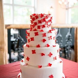 """Falling flowers"" wedding cake"