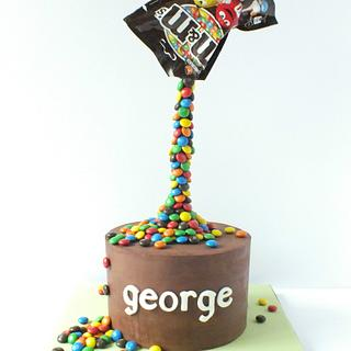 m&m's ganached cake