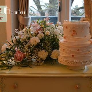 sweet weddingcake with lace, ruffles and little flowerdots