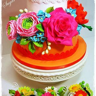 Cake with flowers and cupcakes