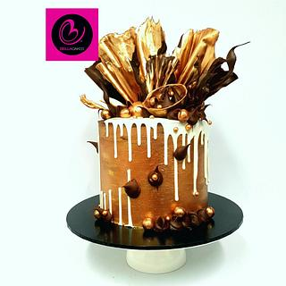 Bronze and dark drip cake