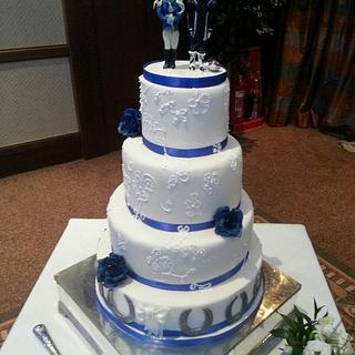 Classic 4-Tier White and Blue Wedding Cake