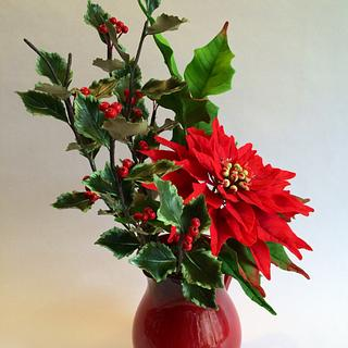 Sugar poinsettia and holly leaves