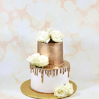 White and gold drip cake