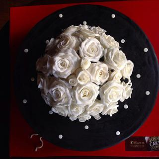 Black cake white roses