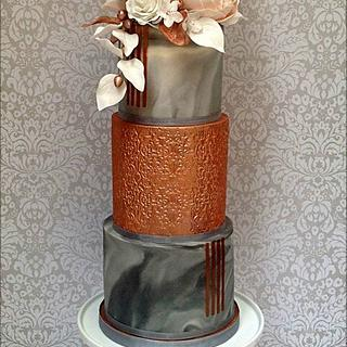 Marble effect and copper lustre wedding cake