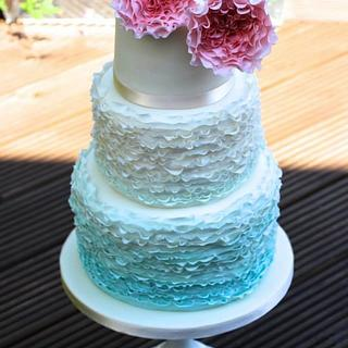 Blue Ombre Ruffle cake with pink David Austin Roses