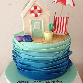 A beach hut themed cake
