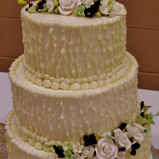 Rain buttercream wedding cake w/ gumpaste flowers