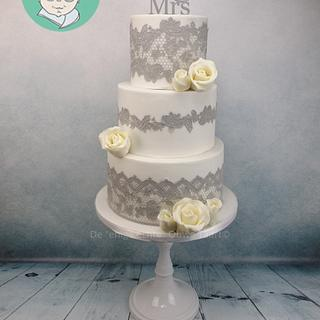 Wedding cake with gray cake lace and modeling chocolate roses