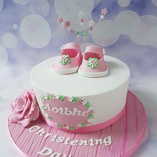 Booties christening cake