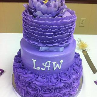 Purple ruffle and rose cake