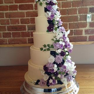 Beautiful purple flower cascade wedding cake