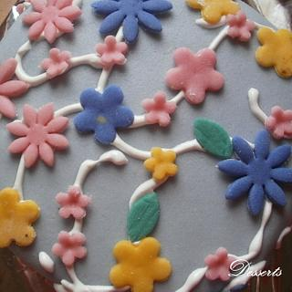 Blueberry cake with fondant flowers and royal icing