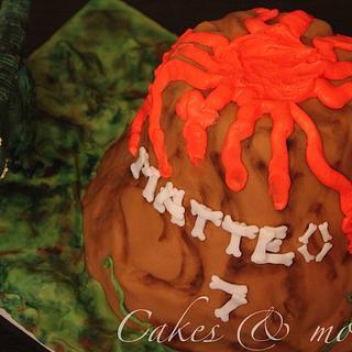 Dinosaur and volcano birthday cake