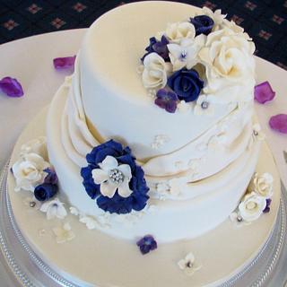 Sumptuous cream and cadbury purple wedding cake