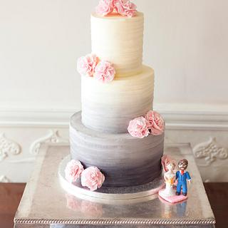 Grey ombre buttercream wedding cake with pink ruffled ribbon roses