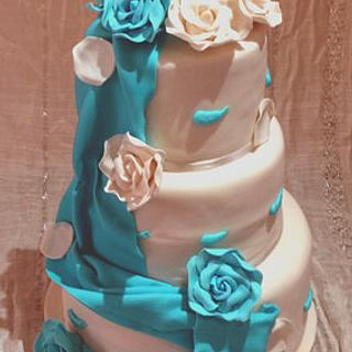 Draped blue and white wedding cake - Cake by HighTeaTighty