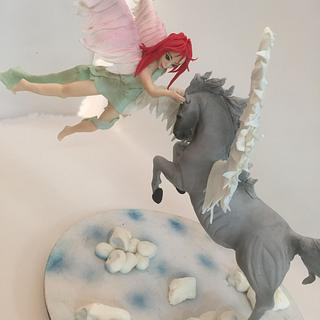 a fairy and a horse topper
