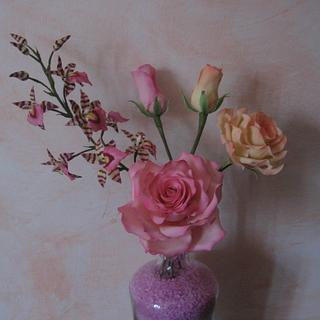Roses and Lemboglossum orchid