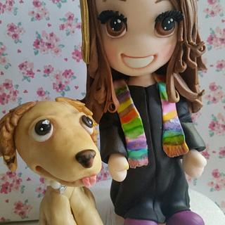 Graduation figurine and pup cake topper