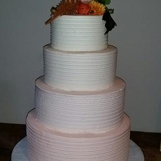 Peach ombre textured wedding cake