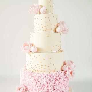 Rose gold sequins and peonies wedding cake