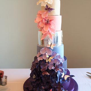 Falling petals wedding cake with butterflies
