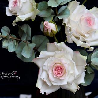 Roses with Eucalyptus twigs