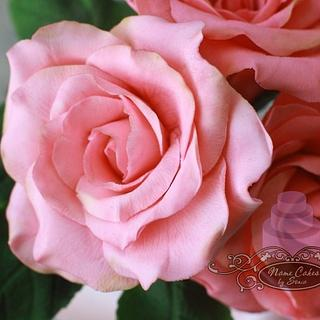 Vase of sugar roses