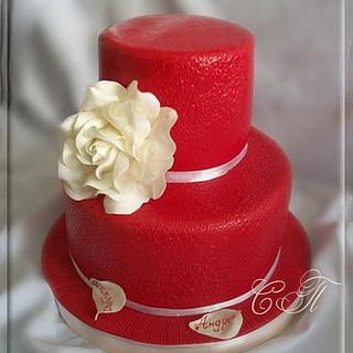 Red wedding cake with white rose