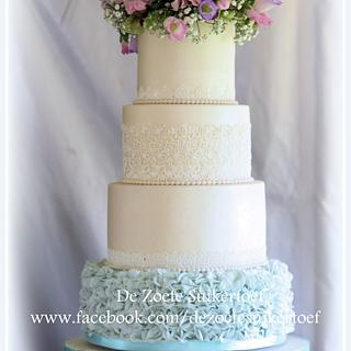Wedding cake with lace and real flowers....
