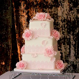 Pink roses and edible lace wedding cake