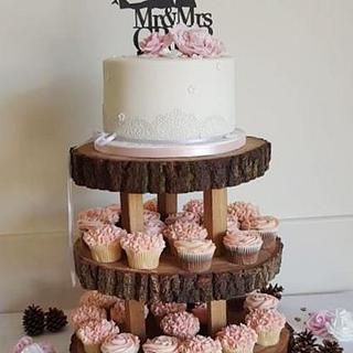 Peony and lace wedding cake and cupcakes