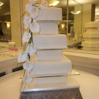 6 tier ivory wedding cake with orchid spray