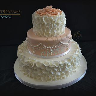 Wedding cake with ruffles and pearls.