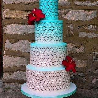 Djerba inspired wedding cake with red hibiscus