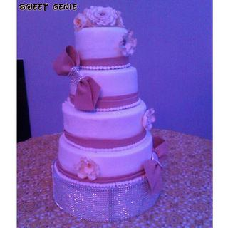 Four tier cake with bows