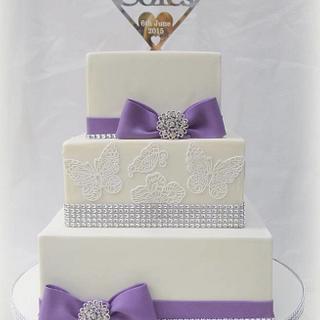 Purple bows, diamante and butterflies wedding cake