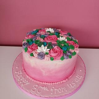 Bright piped flowers cake