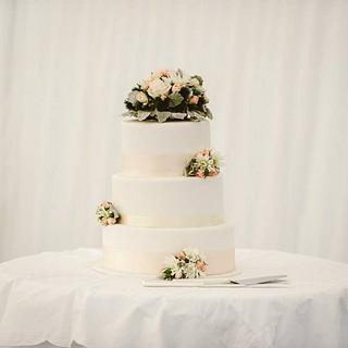 Simple three tier wedding cake with fresh flowers