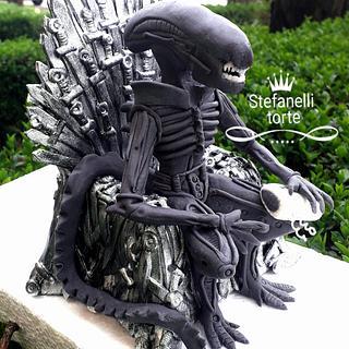 Alien in iron throne cake topper