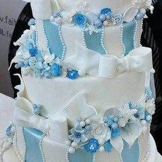 Winter wonderland themed wonky wedding cake