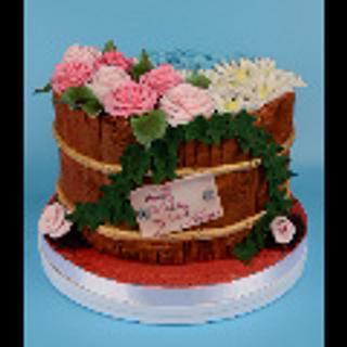 Barrel of flowers cake